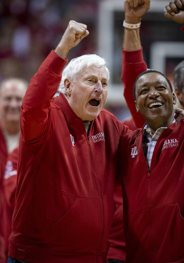 """Former Indiana basketball head coach Bobby Knight, left, yells """"play defense!"""" for the fans during his first appearance at Indiana University since his dismissal in September of 2000"""