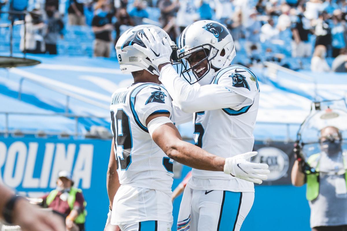 Teddy Bridgewater and Reggie Bonnafon celebrate a touchdown