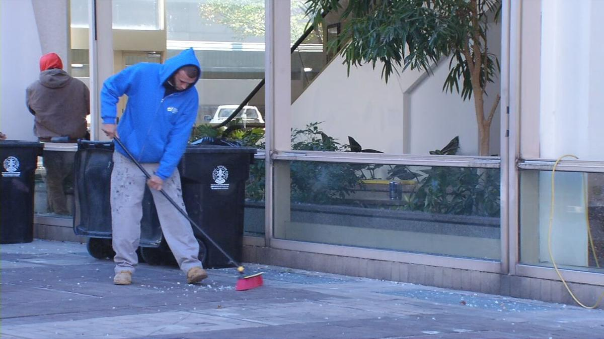 Brown & Williamson sweeping up glass