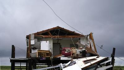 Nicholas storm clouds over destroyed Louisiana home