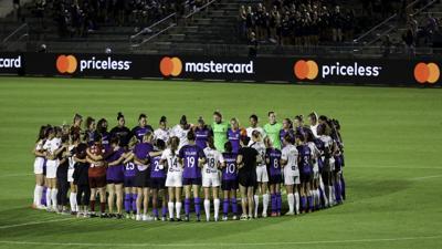 NWSL players huddle