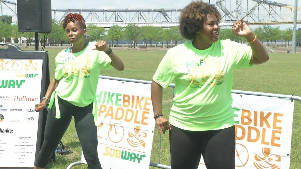 Hike, Bike and Paddle participants dance