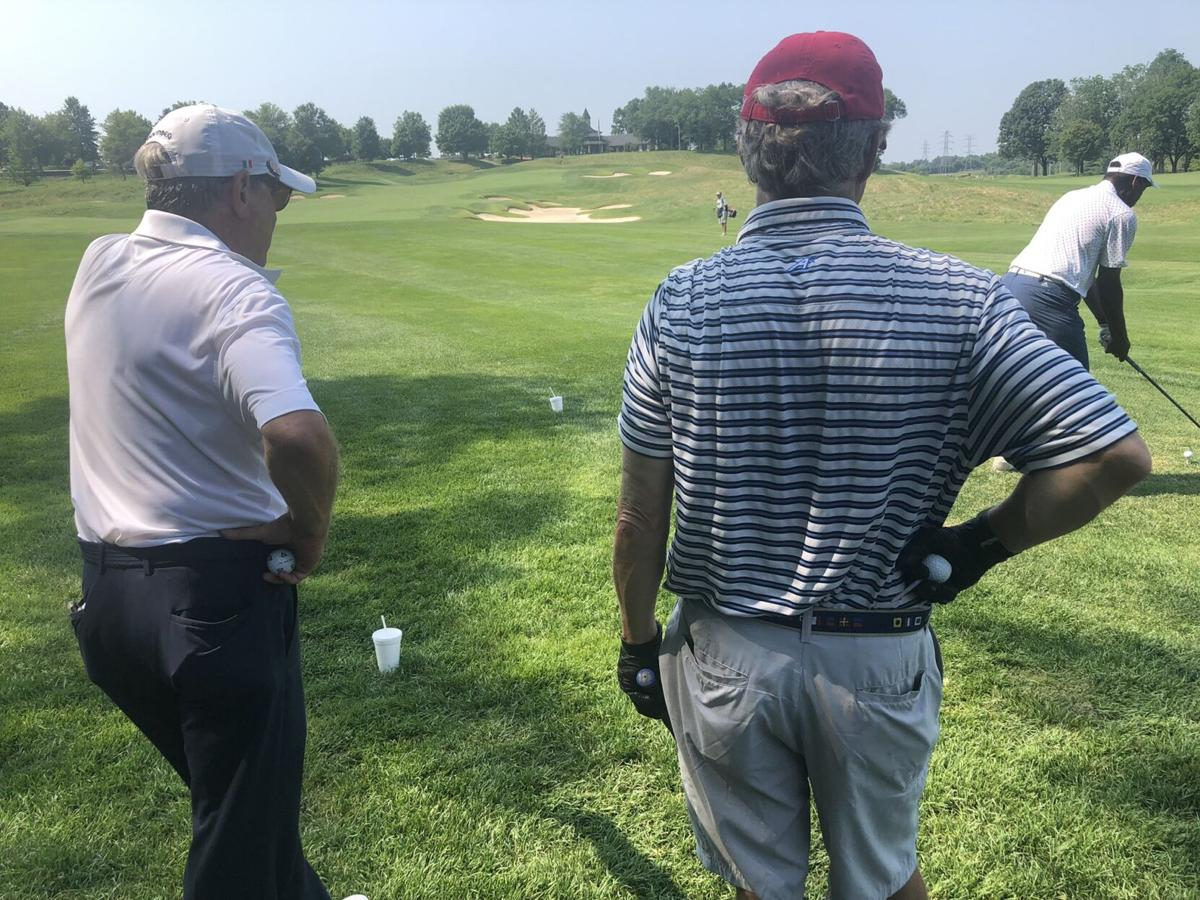 John Yarmuth and Rand Paul at charity golf scramble