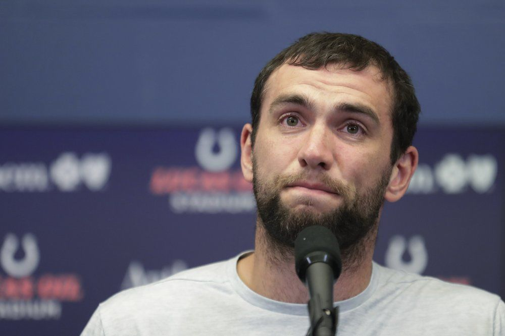 Andrew Luck speaks during a news conference