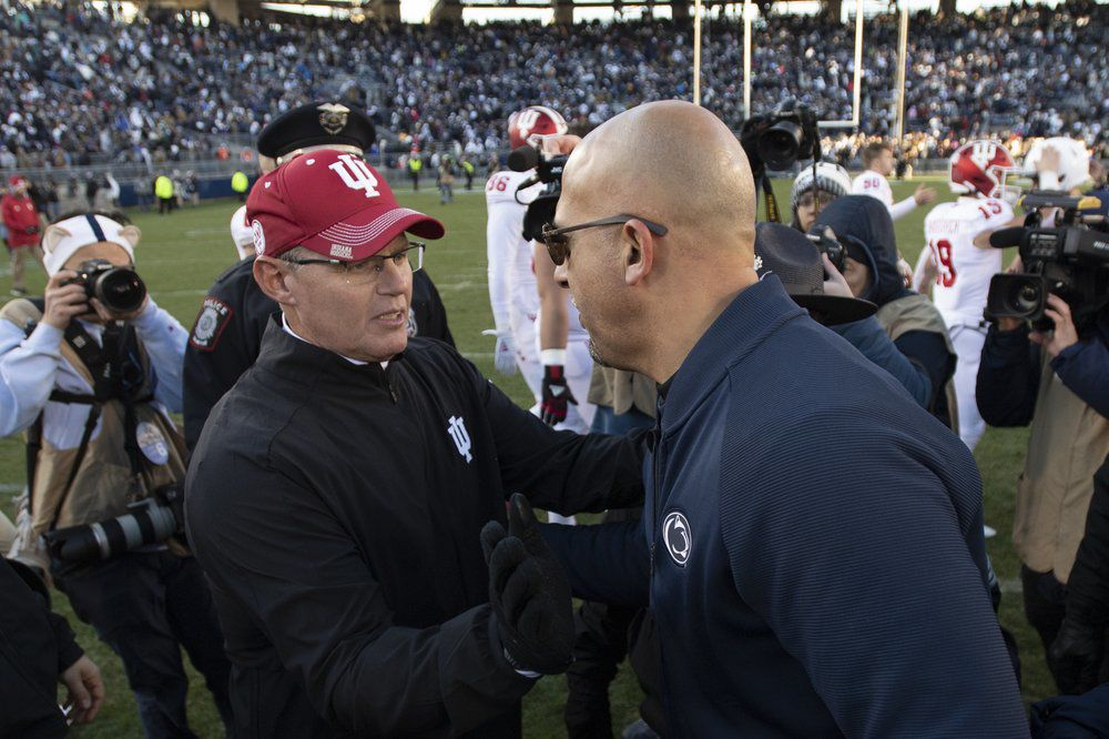 Indiana head coach Tom Allen, left, greets Penn State head coach James Franklin