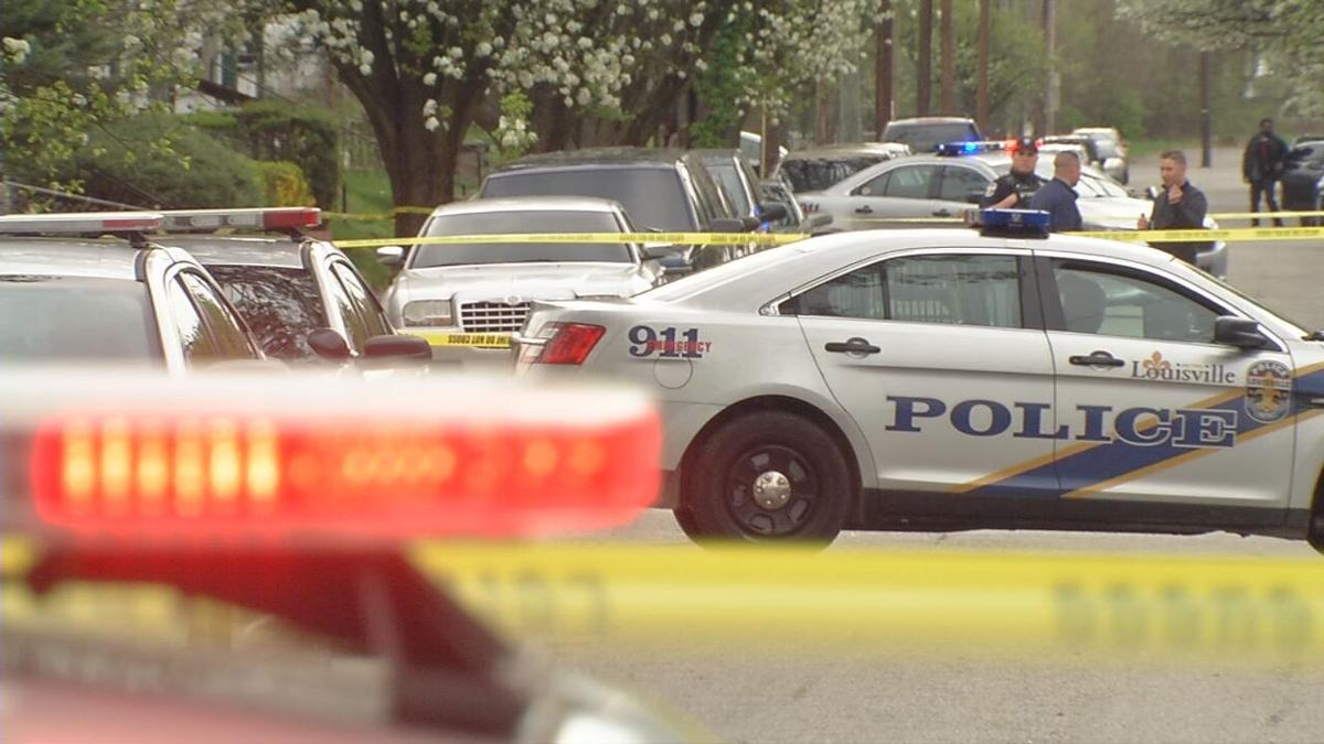 Louisville Metro Police officers respond to a shooting