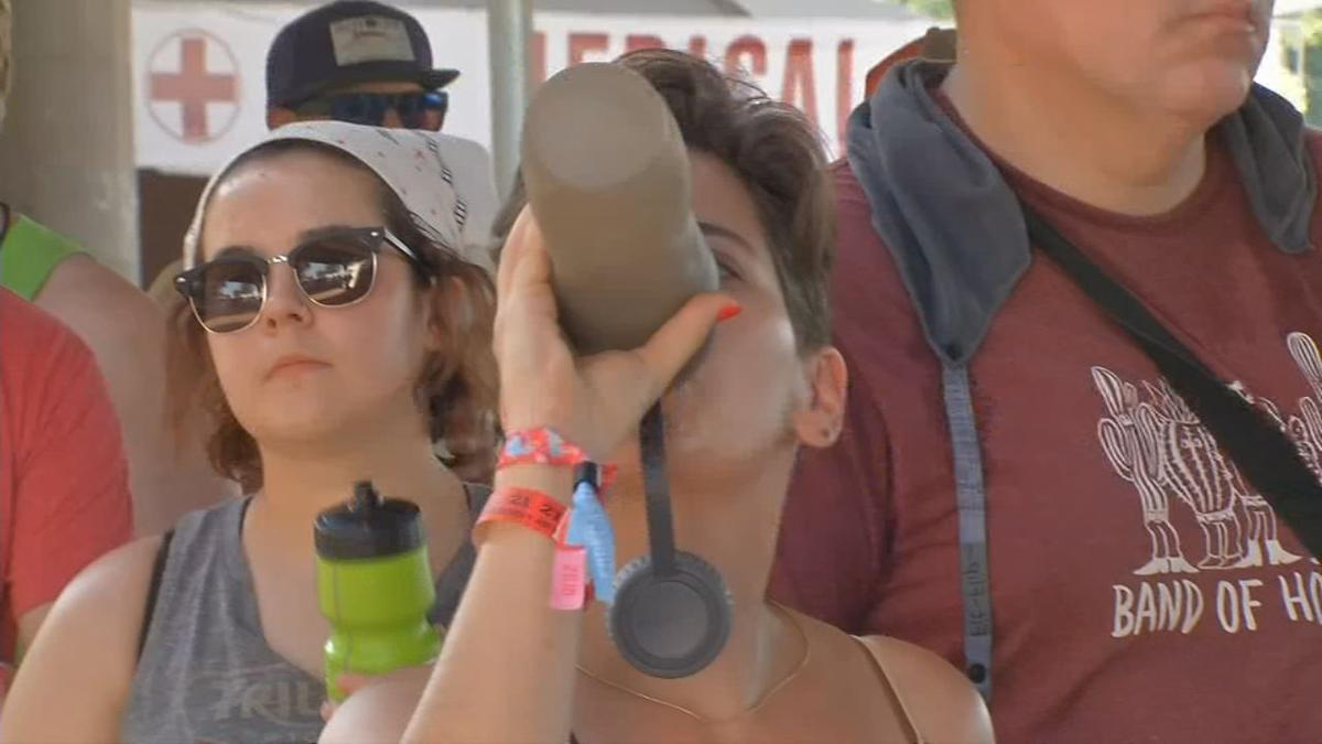 Forecastle Festival attendee with water bottle