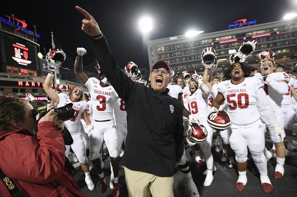 Indiana head coach Tom Allen, center, celebrates with his team