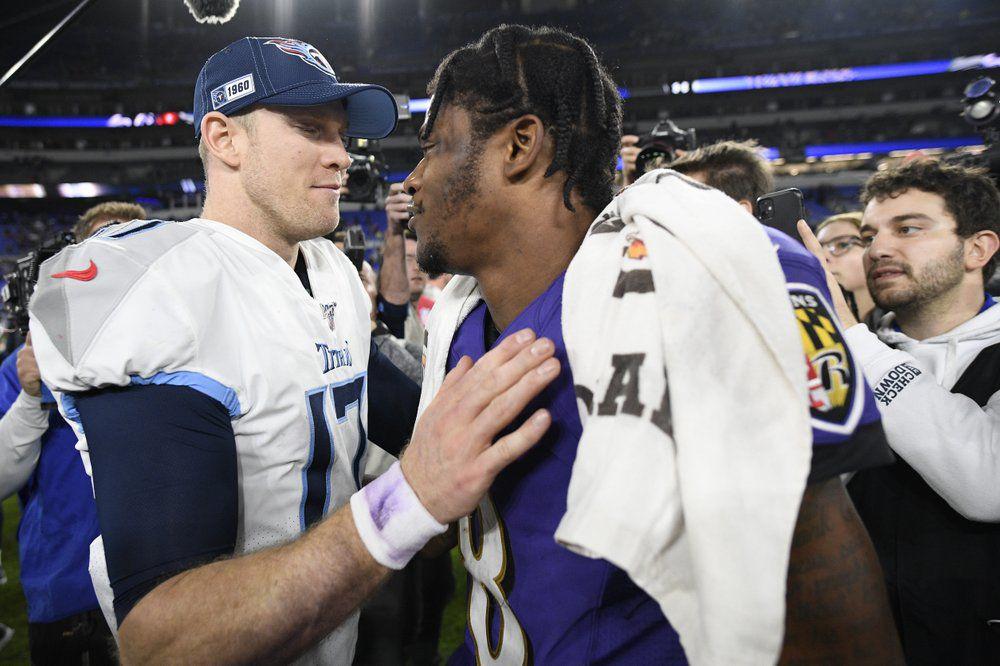 Tennessee Titans quarterback Ryan Tannehill, left, speaks with Baltimore Ravens quarterback Lamar Jackson