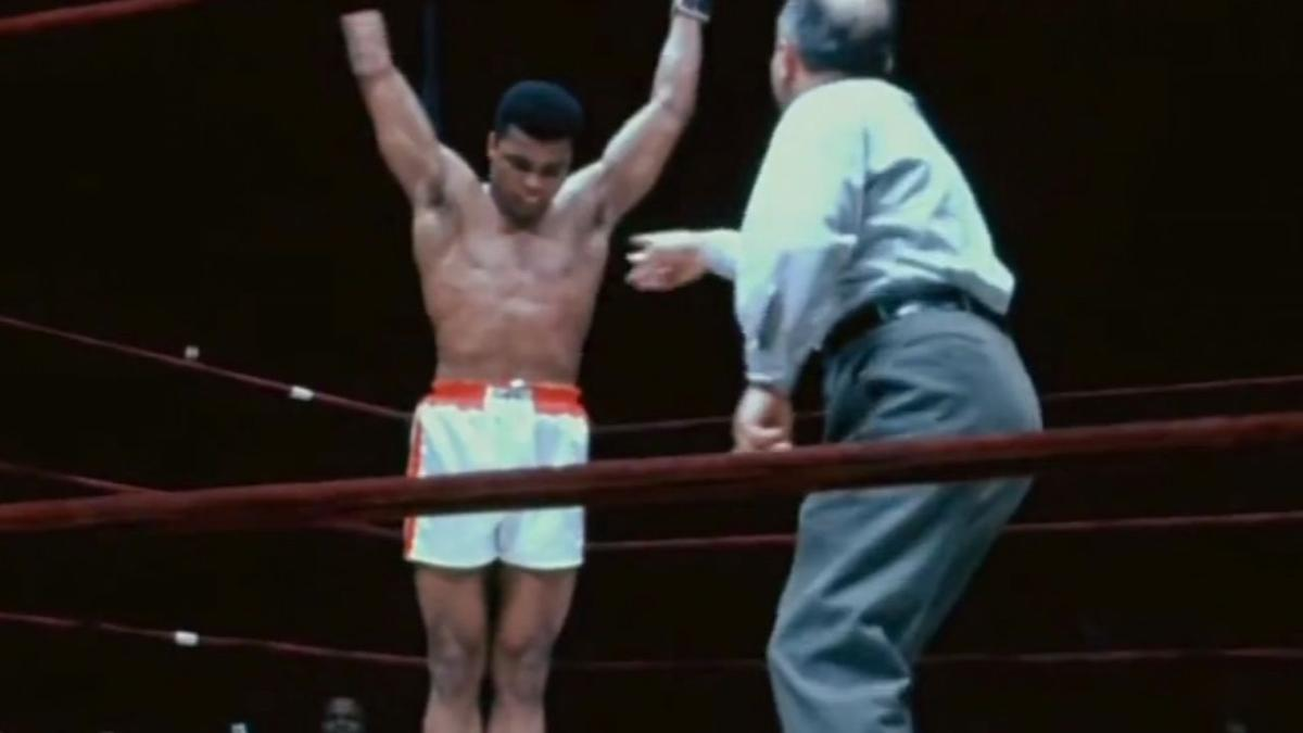 Muhammad Ali in ring with arms raised