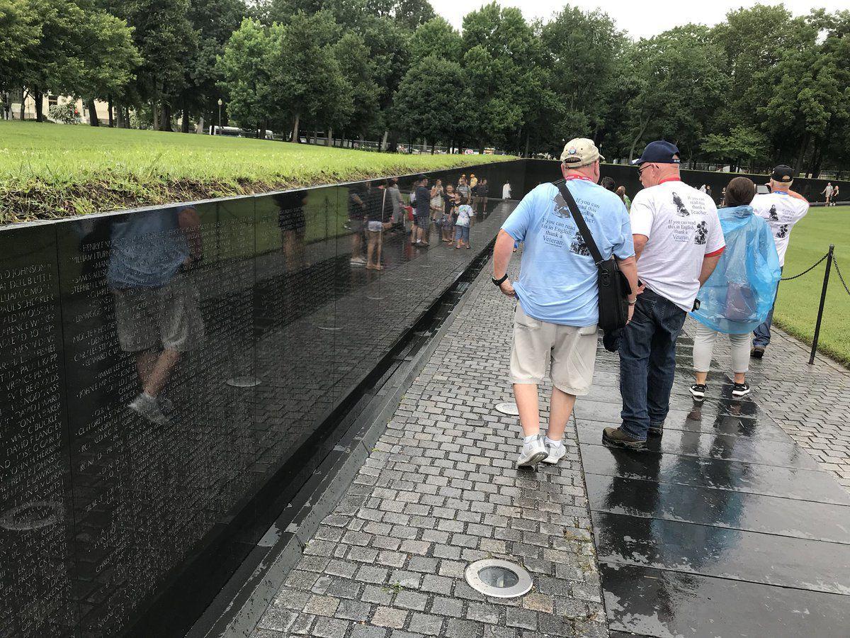 Honor Flight Bluegrass Vets Walk Near Wall