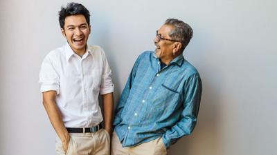 Man next to father