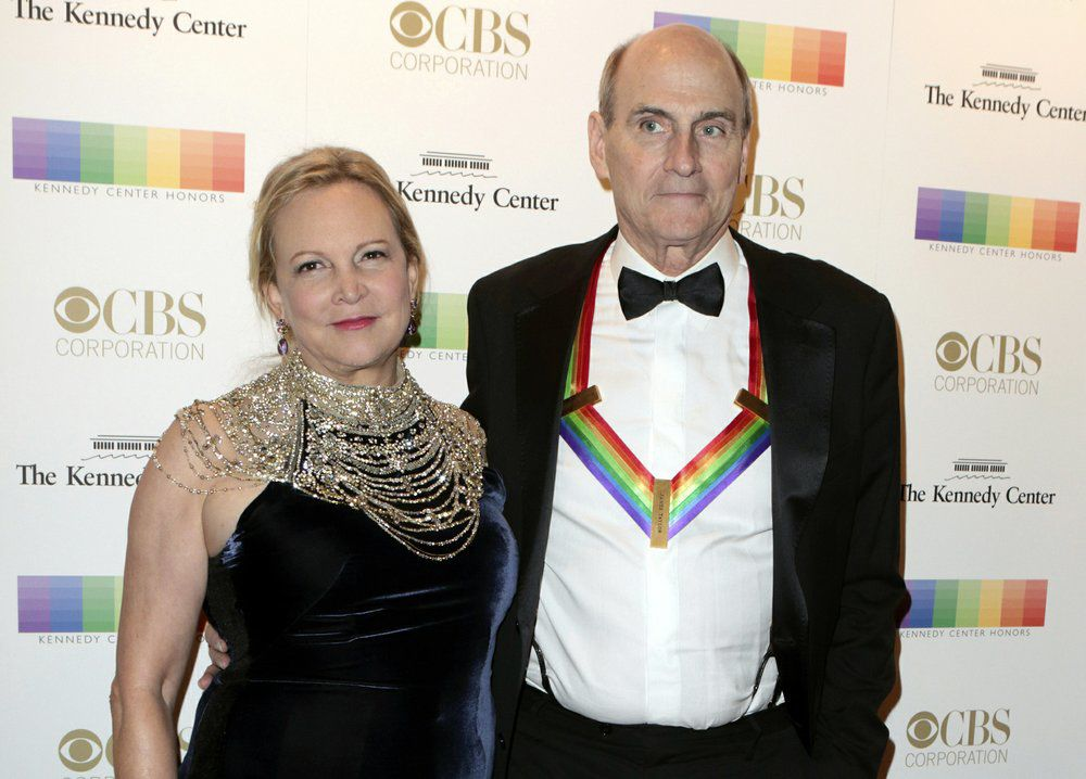 VIRUS - JAMES TAYLOR AND WIFE - AP FILE.jpeg