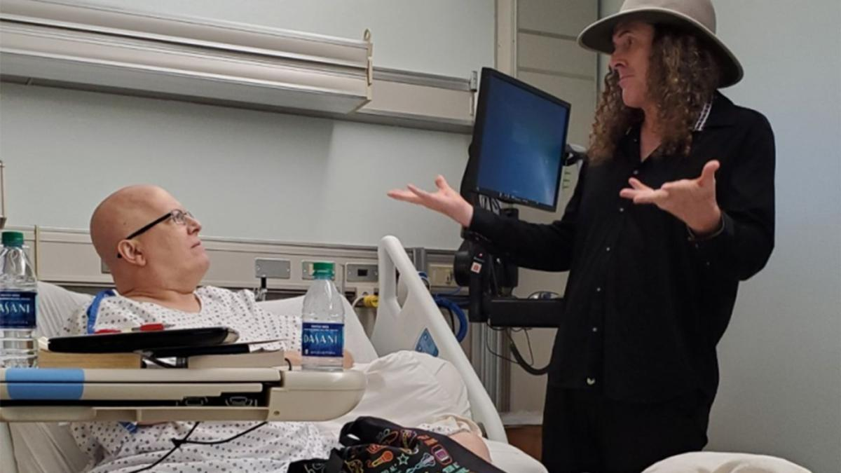 Weird Al Gestures to Lonnie Craig in hospital bed