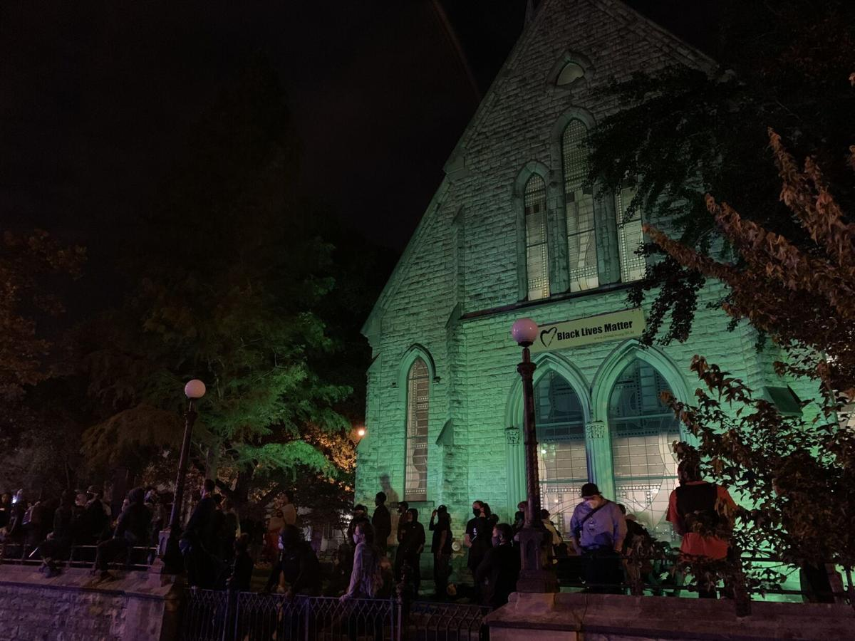 Protesters gather outside First Unitarian Church on 9/24/20