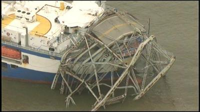 Bridge partially collapses in southwest Kentucky after being hit by cargo carrier