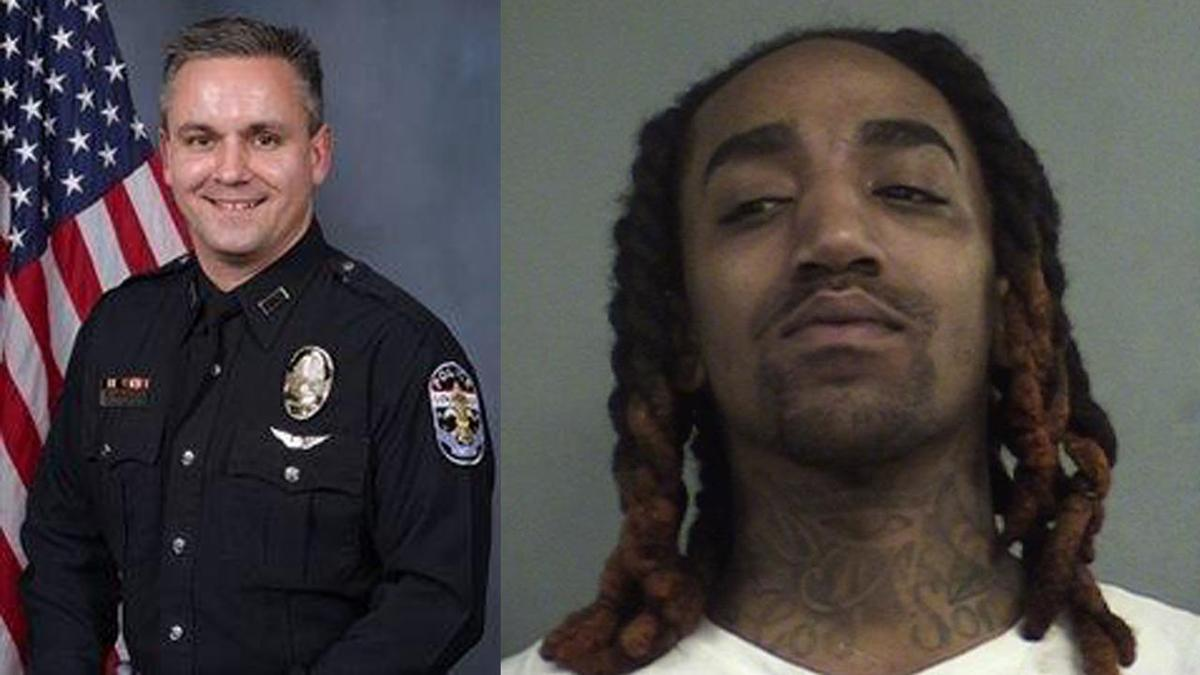 LMPD officer Bryan Arnold and Djuantez Anthony Mitchell