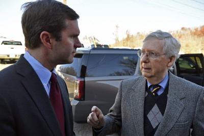 Senate Majority Leader Mitch McConnell, R-Ky., right, speaks with then-Gov.-Elect Andy Beshear