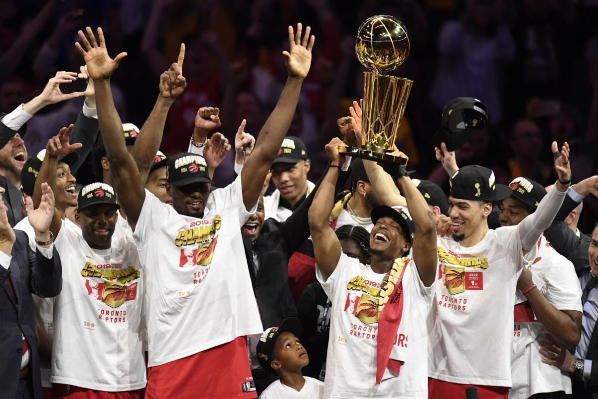 Kyle Lowry holds Larry O'Brien NBA Championship Trophy
