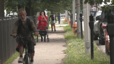 People on sidewalk in Russell neighborhood
