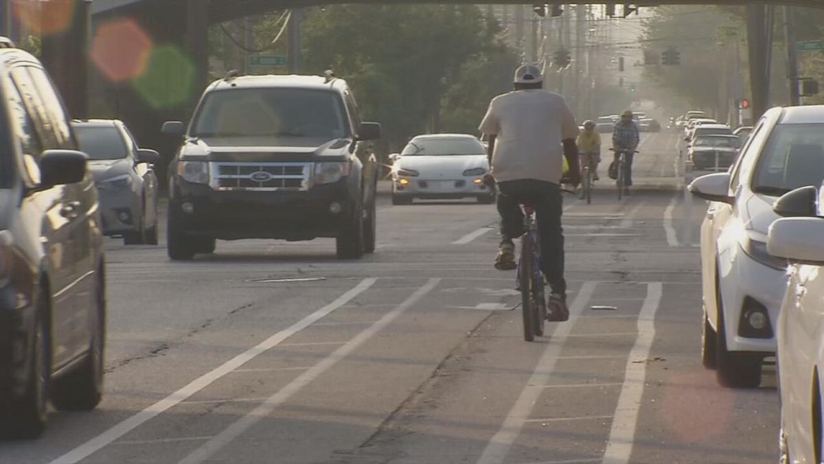 Bikers ride through a Louisville, Ky., street