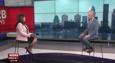 Valerie Chinn and Mayor Greg Fischer (on set)