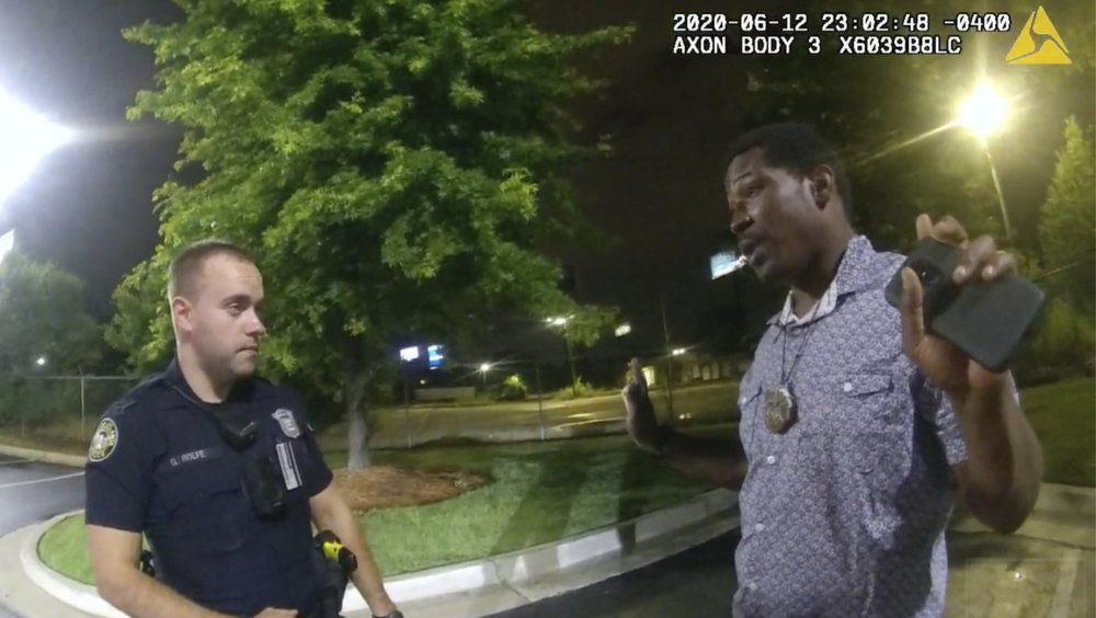Rayshard Brooks speaking with Officer Garrett Rolfe in the parking lot of a Wendy's restaurant, late Friday, June 12, 2020