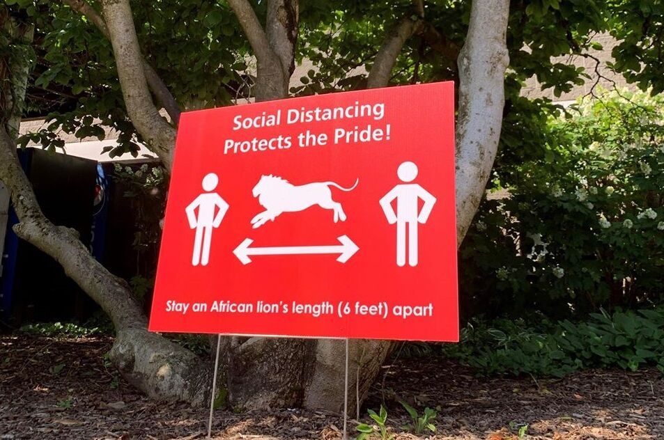 A sign encouraging social distancing at the Louisville Zoo