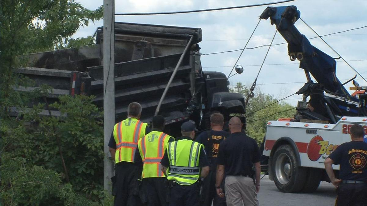 Train crashes into dump truck at busy Jeffersonville