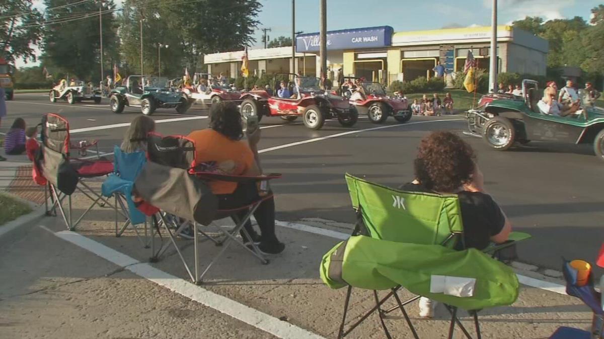 People watch the Gaslight Festival parade in Jeffersontown, Ky.