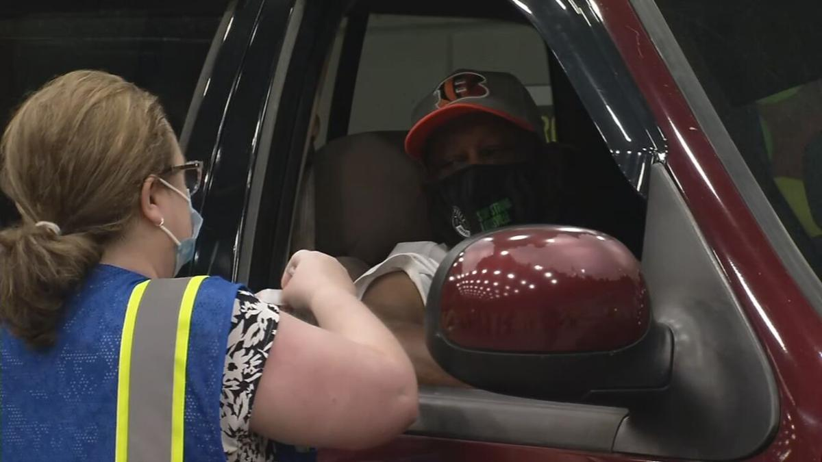 Man receives COVID-19 vaccine shot at the LouVax drive-thru COVID-19 vaccination clinic at Louisville's Broadbent arena
