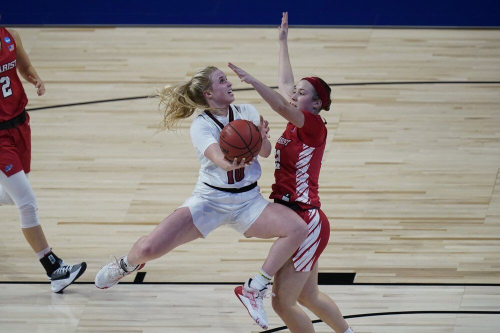 Louisville guard Hailey Van Lith (10) drives to the basket against Marist