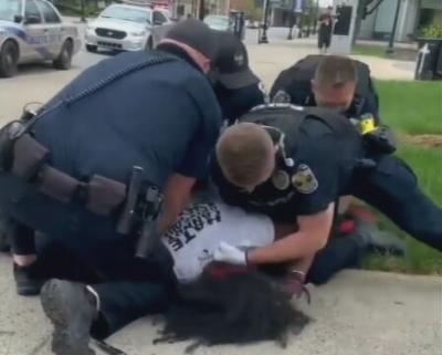 Louisville Metro Police officers arresting Denorver Garrett at Jefferson Square Park