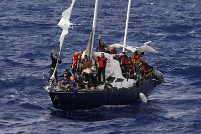 Migrants on boat in Mediterranean Sea