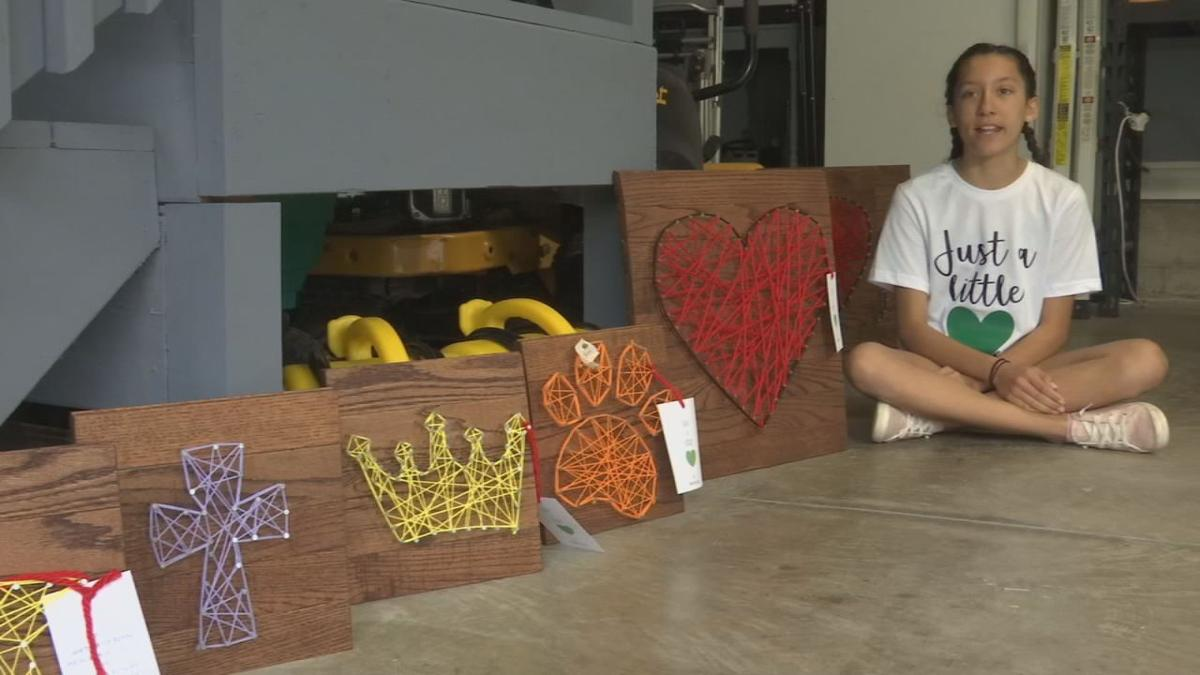 Megan Chelliah poses with string art creations