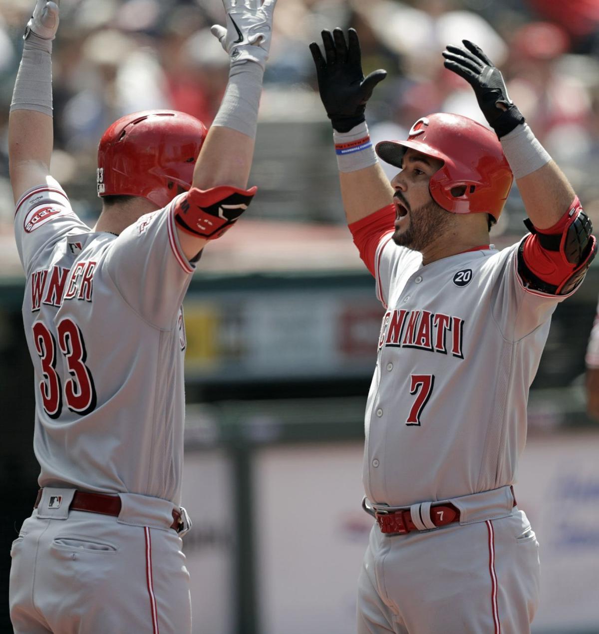 Eugenio Suarez and Jesse Winker celebrate