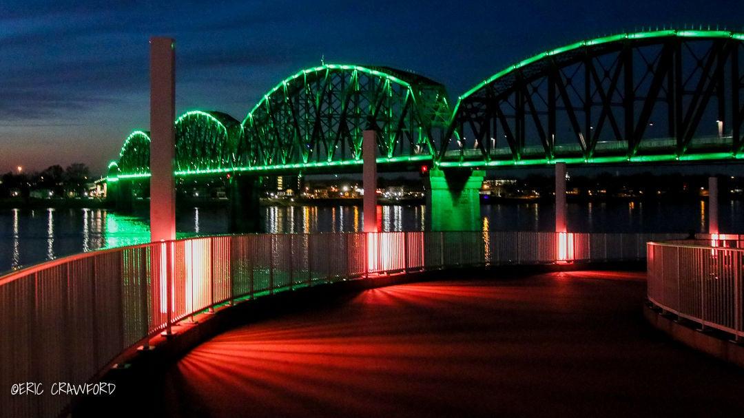 Pedestrian bridge lit up green