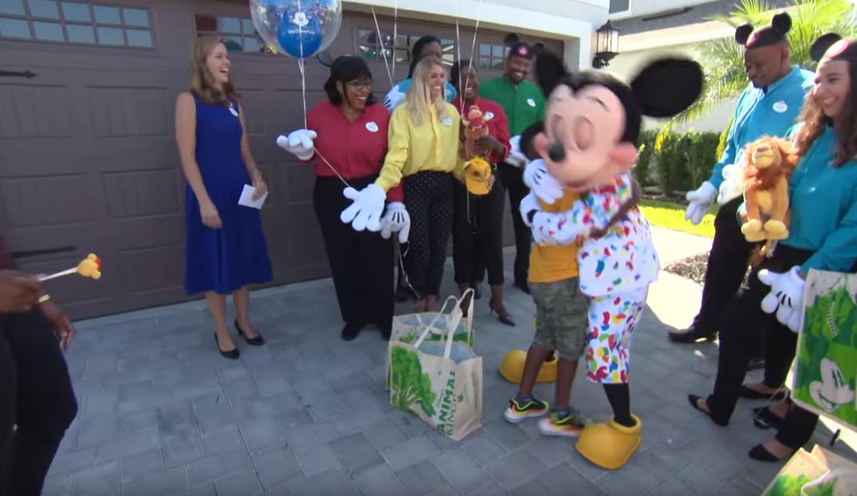 Jermaine Bell hugs Disney character