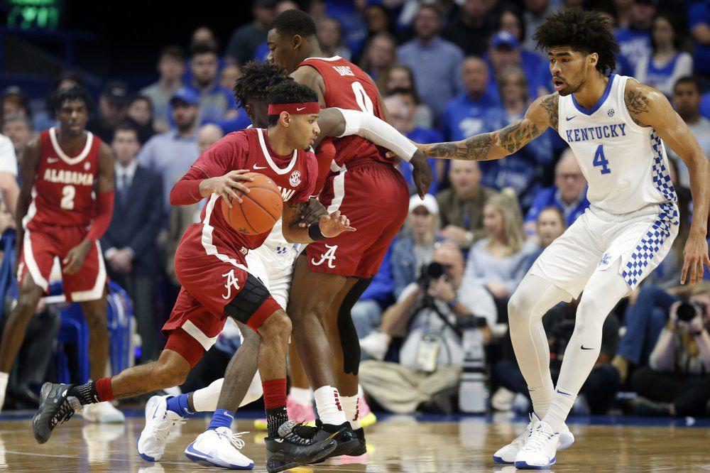 Alabama's James Bolden, left, looks for an opening on Kentucky's Nick Richards