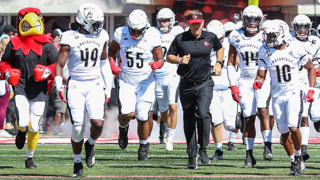 Scott Satterfield and the U of L football team take the field