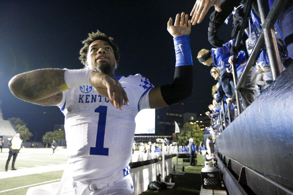 Kentucky's Lynn Bowden Jr. celebrates with fans