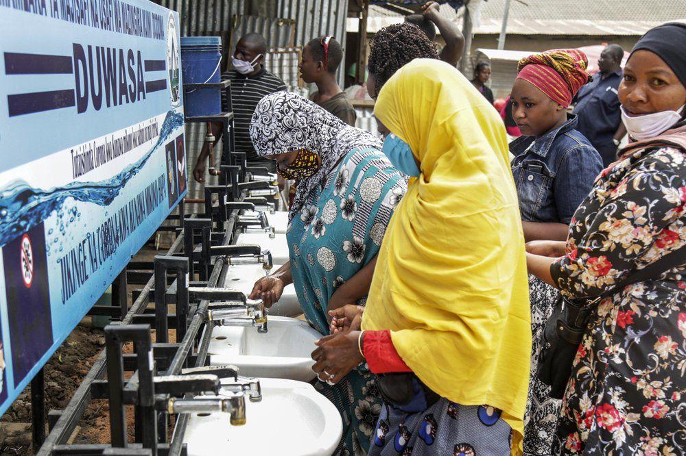 People use hand-washing station in Tanzania