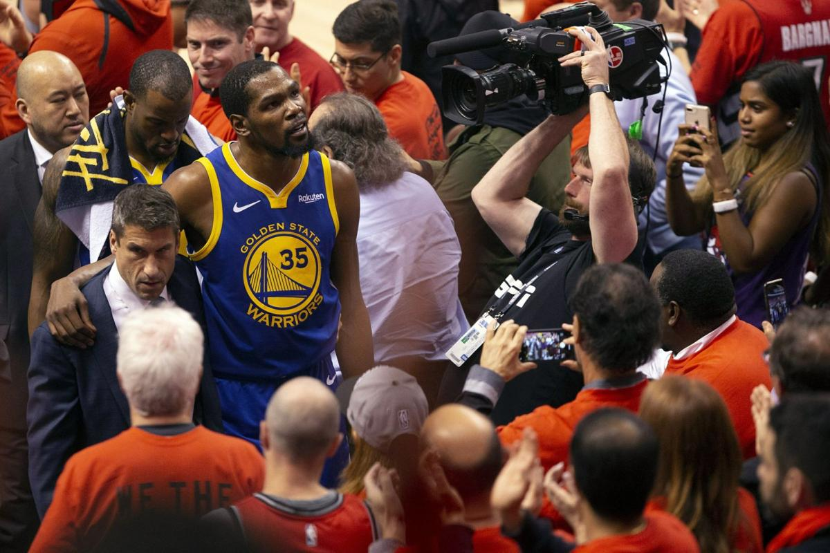Kevin Durant glances up at the stands
