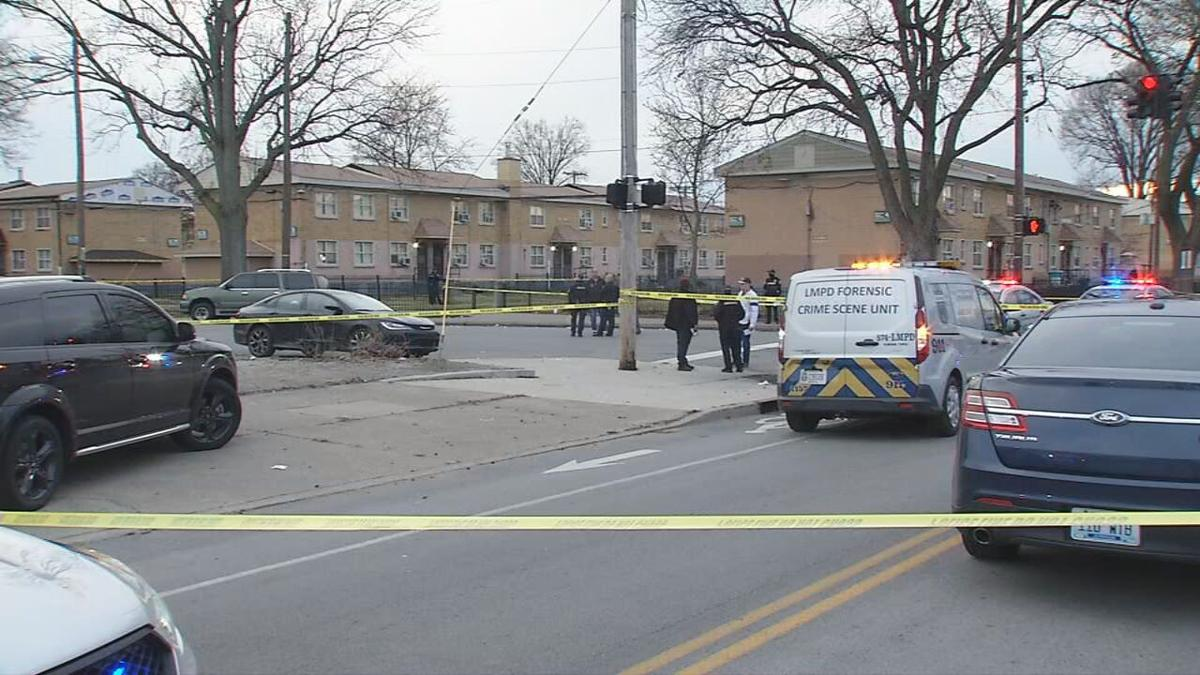Louisville Metro Police respond to a fatal shooting at S. 12th and W. Hill streets