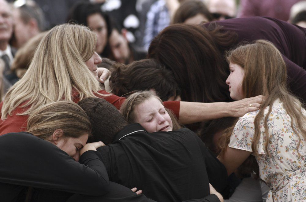 Mexico Massacre - family and friends weep during funeral
