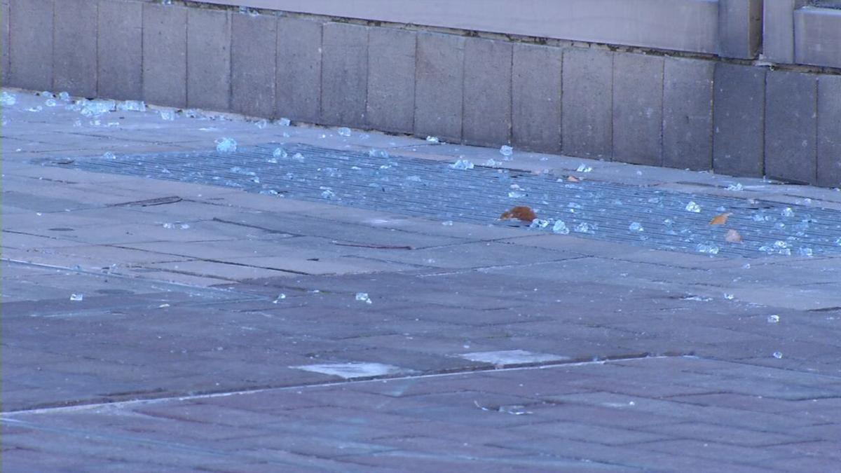 Brown & Williamson broken glass on ground