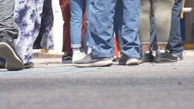 Kentuckians wait for in-person assistance with unemployment benefits outside Louisville's downtown office