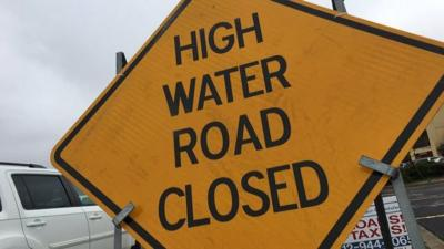 Roads close from flood waters throughout Louisville and Kentuckiana
