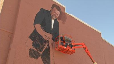 John Mellencamp mural on the side of The Old Guitar Music Store in Seymour, Indiana