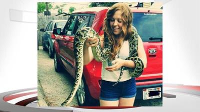 Residents in central Indiana warned after 14-foot Burmese python escapes